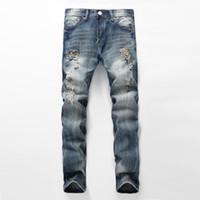 männliche hose neuankömmlinge großhandel-Männliche Jeans-männliches Loch-Retro Art-Flecken-Denim-Hosen-Herbst und Winter-neue Ankunft