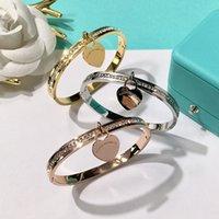 vergoldeten armbänder großhandel-316L Edelstahl Silber armbänderbangles Gold Überzogene Herz Anhänger armbänder für frauen Marke Design