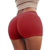 pantalones cortos de gimnasia ajustados mujeres al por mayor-las mujeres manera de la señora elástico de la ropa interior de Europa Rusia Color Rojo Azul sólido lindo delgado apretado que resalta las caderas atractivas Gimnasio partido cortos bragas