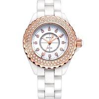 водонепроницаемые часы оптовых-2018 горячие новые модные женские часы, простой белый керамический ремешок для часов, алмазная дрель, водонепроницаемые кварцевые часы.
