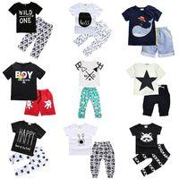 erkek gömlekleri kız tasarımı toptan satış-Çocuklar Giyim Setleri Iki parça 47 Tasarımlar Yaz Erkek Kız Bebek Giysileri Kısa Kollu Pamuklu Gömlek Pantolon Şort 6 M-7 T