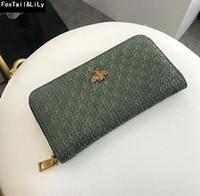 venta de billetera larga al por mayor-Venta directa de fábrica bolso de mujer cartera larga tejida retro billetera de marca ahuecada personalizada billetera de cuero repujado para mujer