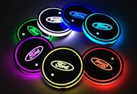 ingrosso ha condotto le luci per la messa a fuoco-2 pz / set Ford mondeo f150 exploror focus Logo distintivo Auto Led Lucido Tazza di Acqua Pad Groove Mat Sottobicchieri Luminosi Luce Atmosfera