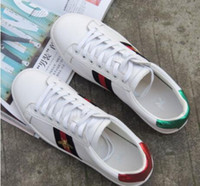 Wholesale women tennis shoes for sale - Group buy Hot new white leather casual shoes Low cut flat printed embroidery tennis shoes Young men and women wild walking shoes