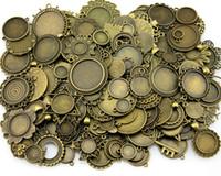 ingrosso antico base cabochon cammeo-100Gram Mix Disegni Bronzo Antico Argento Antico In lega di zinco Ciondolo bianco Cameo Cabochon Base Accessori per gioielli