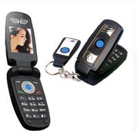 супер маленький сотовый телефон оптовых-Оригинал разблокирован Ulcool V1 X6 супер маленький флип Quad полосы суперкар специальный мини мобильный сотовый телефон ключ автомобиля