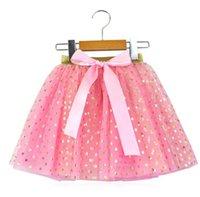 pajarita de oro para niños al por mayor-Kid Pink Foil Prnted faldas elásticas para la etapa Bow Tie Heart Star impreso Tu Tu Faldas para niña faldas de lunares