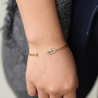 ingrosso oro del braccialetto della mano di hamsa-Forma rotonda di colore oro Lucky Evil Eyes turco Hamsa mano aperta BangleBracelet lunetta blu pietra cz donne gioielli dropshipping