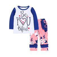 butik ruffle pants toptan satış-Bebek fırfır kıyafetler kızlar mektubu üst + Çiçek baskı pantolon 2 adet / takım 2018 Butik çocuk Giyim Setleri C3625