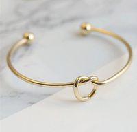 bindungsknotenarmbänder großhandel-Europa Und USA Metall Gold, Splitter, Rose Gold Farbe Schmuck Einfache Wind Armband Personalisierte Knoten Geschenke Armband Krawatte Bangle Unisex