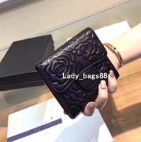 dobrando mulheres bolsa venda por atacado-Mulheres de luxo Designer de carteiras carteira curta titular do cartão de crédito carteira preta de Alta Qualidade Bolsa Da Moeda De Couro Genuíno Três Dobr ...