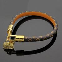 ingrosso marchio di braccialetti-Braccialetti di alta qualità rotonda in vera pelle con accessori borsa d'oro design per donne e uomini fiore braccialetto di marca di marca gioielli