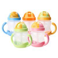 gelbe babyflaschen großhandel-280ml Cute Baby Cup Kinder Kinder Lernen Fütterung Trinkwasser Stroh Griff Flasche mamadeira Sippy Training Cup Baby Fütterung Cup