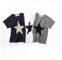 moda infantil impresa camisetas al por mayor-Nueva moda de verano niños niños niños ropa de algodón estrella de manga corta T-shirt tops camisetas niños niños estrella de impresión camiseta