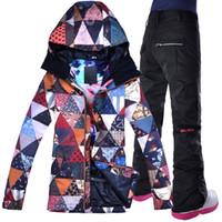 ropa de nieve al por mayor-2018 GSOU SNOW Mujeres Traje de esquí Chaqueta de snowboard Pantalón Ropa super caliente Pantalón de invierno Mujer Pantalón Traje de esquí con capucha Conjunto
