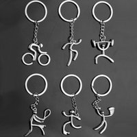 Wholesale play boy men - 2018 Sports Run Weightlifting Play Tennis Football Basketball Cycling Figure keychain Metal Keyring Souvenirs Creative Gift