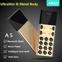 celular de celular desbloqueado venda por atacado-AEKU desbloqueado original A5 bluetooth 3.0 GSM telefone celular móvel bluetooth discador Música Playe Inteligente Anti-roubo corpo de Metal mini celular