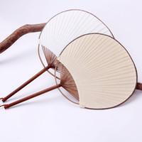 weiße papierhandfächer großhandel-Weißer Paddel-Papierfan der japanischen Art mit Quasten-Partei bevorzugt Geschenk-runde Handwerks-Fans