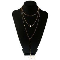 long collier sexy achat en gros de-Nouveau Or Sexy Collier Multicouche Long Alliage Faux Perle Pendentif Corps Chaîne Bijoux En Gros
