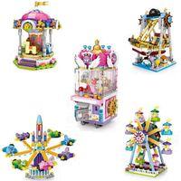 mini bloque de series de juguetes al por mayor-LOZ Parque de Atracciones Serie Mini Coche Ferris Rueda Rotary barco pirata Muñeca Máquina bloques Juguete de Navidad niños ladrillos educativos