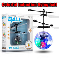 Wholesale flashing kids toy lights resale online - Flying copter Ball Aircraft Helicopter Led Flashing Light Up Toys Induction Electric Toy sensor Kids Children Christmas with package