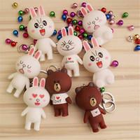 ingrosso coniglio coppia carina-Popolare fumetto e sorpresa action doll figura squishy carino piccolo orso coniglio bambola campana portachiavi ciondolo coppia.