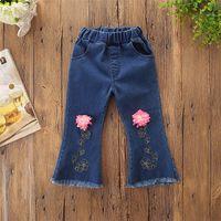 niños bordados al por mayor-Las muchachas del bebé de la borla de los pantalones vaqueros de la flor 3D bordan el corte de pantalones de mezclilla bolsillo de la cintura elástica niños primavera otoño roto pantalones Boutique ropa