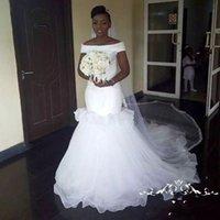 volantes velo al por mayor-Sirena africana vestidos de novia fuera del hombro volantes en capas Tulle Beach vestido de novia Barato Conde Tren Dubai vestidos de novia sin velo