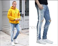 pequeños pies de jeans al por mayor-Alta calidad nueva caliente 18SS PISTA JEAN LIGHT Jeans para hombres Lavado de agua vieja barra blanca Hip hop de la calle alta Pantalones de pies pequeñosJustin bieber