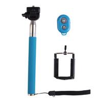 ausziehbares handheld für iphone großhandel-Drahtlose Bluetooth Erweiterbar Self Selfie Stick Handheld Einbeinstativ + Clip Holder + Shutter Remote Controller für iPhone Android