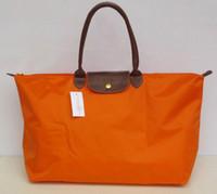 ingrosso borsa arancione modello-Moda vendita calda Borsa da viaggio di lusso da donna Arancione Fuchsia famosa marca Nylon borse singola cerniera Modello incrociato frizione ragazza