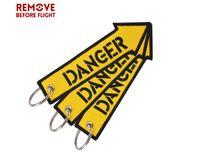 quitar etiquetas al por mayor-Quitar antes de los regalos de vuelo Danza Rescate Etiqueta clave Llavero para motocicletas Scooters y automóviles Llaveros OEM Llavero Joyería