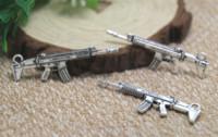 charmes d'armes achat en gros de-10pcs / lot mitraillette Charms Antique Silver Tone 2 pendentifs charme de mitrailleuse 45x16mm