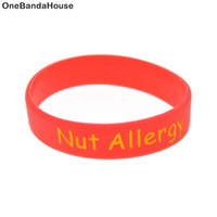 Wholesale life size silicone - Wholesale 100PCS Lot Medical Alert! Nut Allergy Silicone Wristband Children Size Bracelet As A Reminder in Daily Life