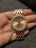 las mujeres miran el precio barato al por mayor-Diamante relogio feminino nueva Dama de la moda Diseño Rosa Vestido de oro Señoras de la marca de gama alta relojes Mujer tira de acero precio caliente barato buen reloj