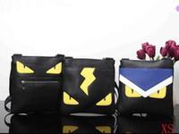 дизайнерские портфели женщин оптовых-Мужские сумки через плечо Портфель сундуки с надписью Vintage PU женщины Кожаные плечевые сумки через плечо Дизайнерские глаза Монстр унисекс Повседневные сумки