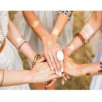 diseños de tatuajes metalicos al por mayor-120 clases de arte de diseño manera de la carrocería metálicos tatuaje plata del oro de una sola vez para no tóxicas impermeables atractivos de las mujeres Tatuajes Productos Pegatinas