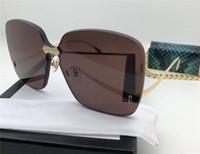 Wholesale decorative sunglasses - Popular New fashion designer sunglasses women frameless thicken lens light summer high-end decorative eyewear top quality