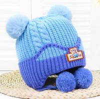 desenhos de boné de inverno bebê menino venda por atacado-Chapéu quente earflaps inverno para o bebê infantil menina menino recém-nascido tampa da orelha chapéus bebê cap tricô design foto chapéu da criança