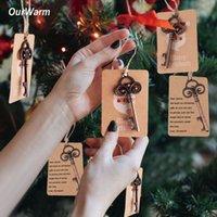 etiquetas artesanales al por mayor-Ourwarm 10 Set Decoraciones para árboles de Navidad Abrebotellas + Etiquetas de regalo de Santa Colgante de Navidad Adornos de la gota Diy Craft