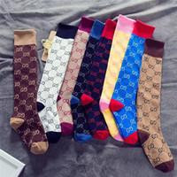 meias japonesas venda por atacado-Adolescente Meninas Meias Moda Outono Inverno Crianças Meias Médias High-end Carta Algodão Meias Estilo Japonês Estudantes Quentes Meias 5C