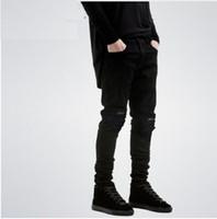 marcas famosas designer jeans venda por atacado-New Black Jeans Rasgado Homens Com Buracos Denim Super Skinny Famoso Designer Da Marca Slim Fit Calças Jeans Motociclista Rasgado Jeans