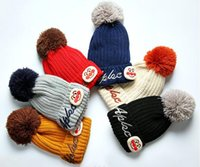 Wholesale balls smiles for sale – custom Colorful hair ball children s embroidery smile letter wool cap Baby cartoon tide hat Christmas wool hat