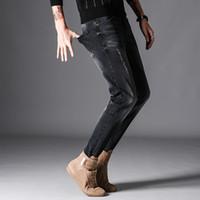 vaqueros pitillo desgastados negros al por mayor-Denim Black Skinny Jeans Hombres Diseñador Ripped Denim Jeans Casual Algodón Stretch Jean Hombre Slim Fit Jeans de calidad Homme