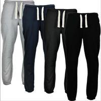 los hombres calzan pantalones deportivos al por mayor-Pantalones deportivos Runing para hombre Pantalones Slim Fit de color puro Pantalones Fitness Hip Hop Fashion Jogger Pants