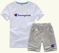 ingrosso riassunti di pugile nylon blu-ragazzo Foto Marca Bambini Imposta bambini T-shirt e pantaloncini Pantaloni bambini Tute Bambini Sport Suit 2 pezzi manica corta