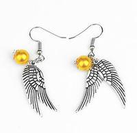 ingrosso perline in bronzo-Orecchini con ali dorate Orecchini con perline dorate Orecchini pendenti Charm Argento antico con ali d'argento per gioielli di moda per donna
