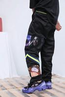 baile en el que te desnudas al por mayor-2018 90s Alta calidad nueva japón Moda hiphop Rap street dance Mosaico de dibujos animados tira verde fluorescente Hombres mujeres pantalones de niebla Pantalones casuales