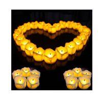 Wholesale pink flicker - 12PCS  LOT Flameless Battery Christmas LED Tea Light Flickering Amber Tealights Candles