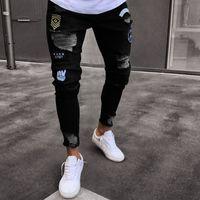 случайные черные отверстия для брюк оптовых-Новый 2018 Мужская отверстие вышитые джинсы тонкий мужчины брюки повседневная тонкий летние джинсовые брюки Классические ковбои молодой человек черный синий